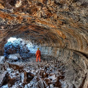 Caver in large lava tube
