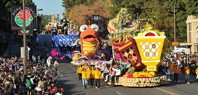 A float and marchers in the Rose Parade