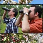 River Fest visitors looking through binoculars