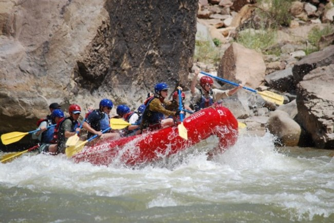 people whitewater rafting on a river
