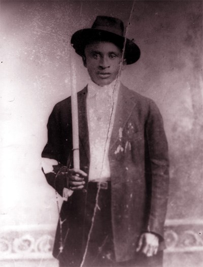 Amédé Ardoin in brimmed hat and jacket, in 1912