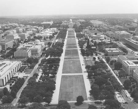 An aerial view of the mall towards the Capitol show the layout of turf and trees