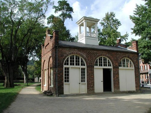 John Brown's Fort, originally a fire engine and guard house, is brick with three arched doorways.