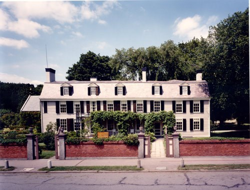 Contemporary image of the Old House, a two-story home with many windows.