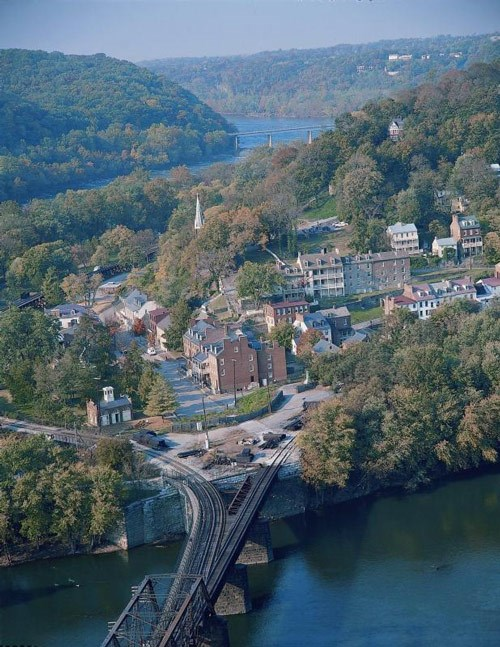Aerial view of Harpers Ferry, showing the town surrounded by rivers and hills.