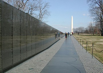 From the Vietnam Veterans Memorial, the Washington Monument is seen rising over the west knoll of Constitution Gardens.