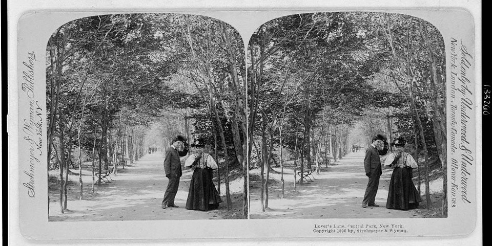 Stereoscopic photo shows side-by-side images of a man tipping his hat to a woman on the edge of a wooded pathway.