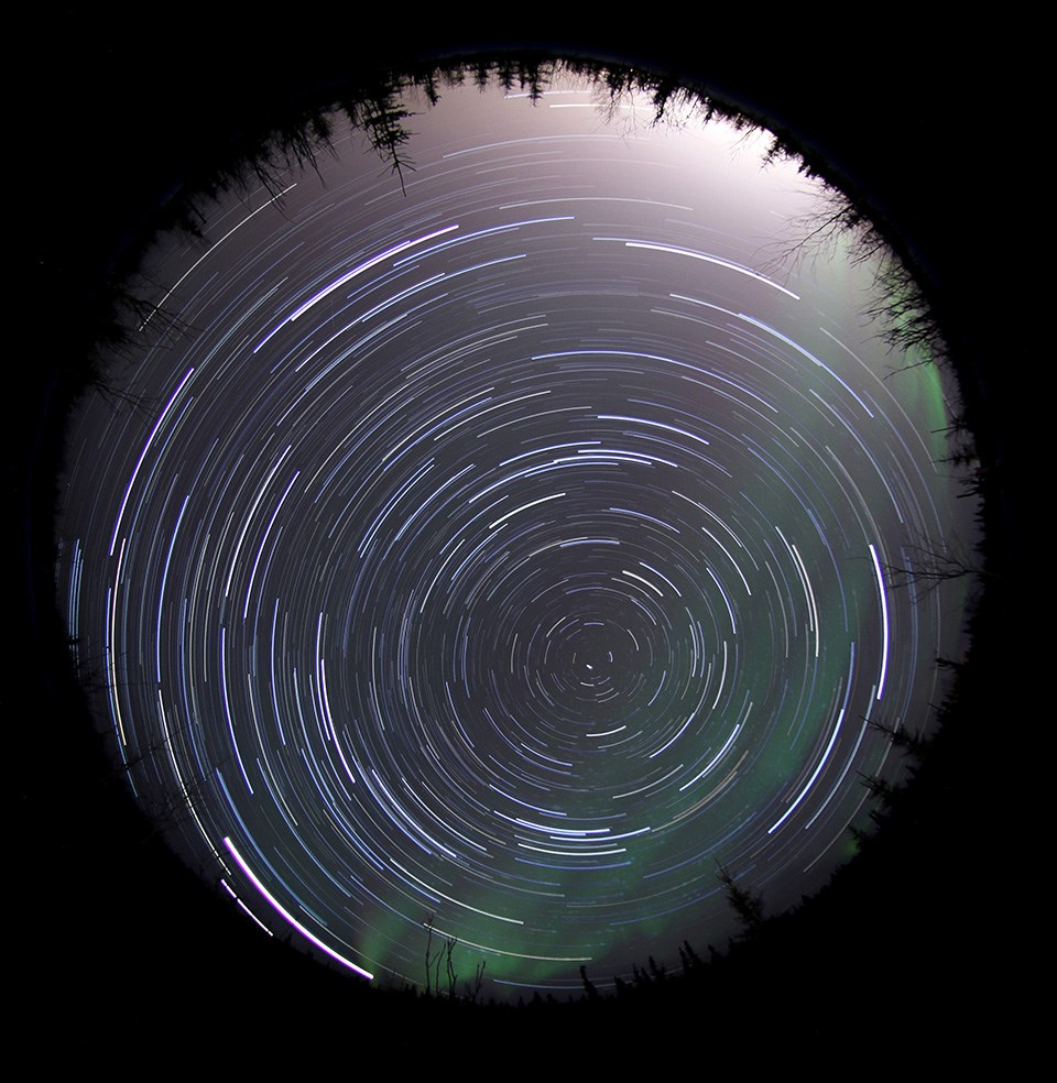 Star trails in the far northern sky appear as circular streaks
