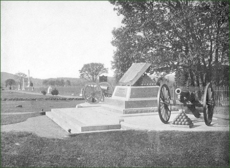 Cannons, monuments, and stone walls are part of the Gettysburg landscape.