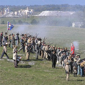 civil war reenactment with mine in background