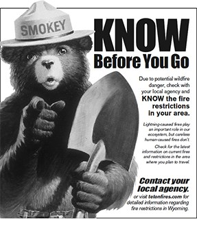 Ad with Smokey Bear and message Know BEFORE You Go.