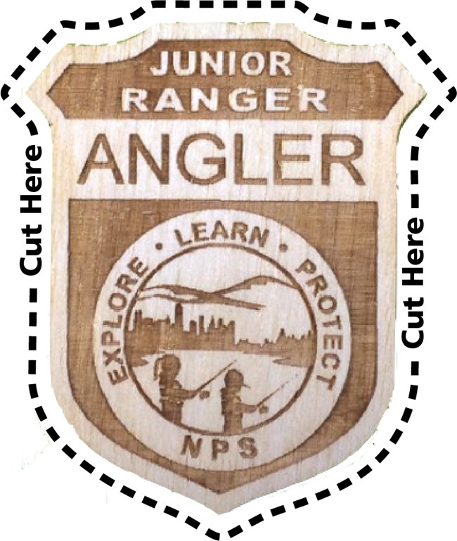 Junior Ranger Angler badge. Badge artwork says Explore, Lear, Protect, NPS. Image inside circle shows two children fishing at a lake near a city.