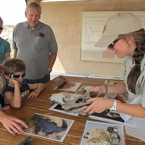 Ranger showing fossils to park visitors