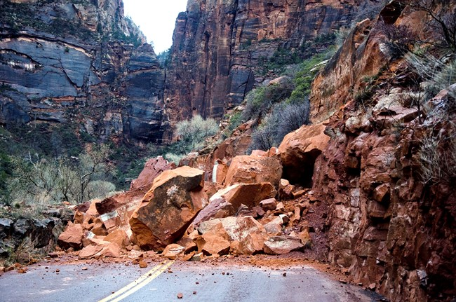 rockfall debris blocking a park road