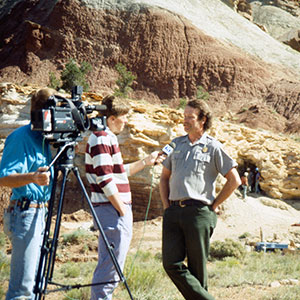 A film crew interviews a park ranger for a documentary at Capitol Reef NM.