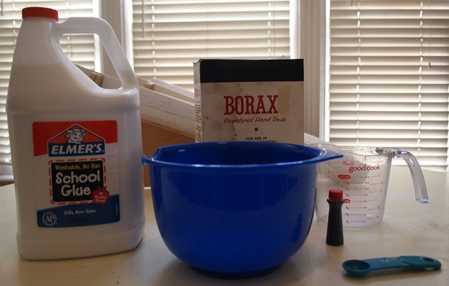 Glue, borax, water, food coloring, and utensils for making flubber