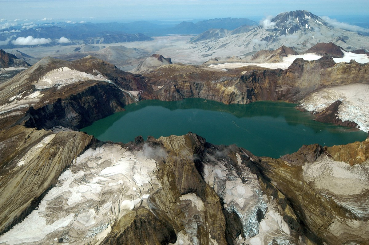 volcanic landscape with glaciers and caldera lake