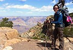 tiny thumbnail of person standing near the rim of the grand canyon