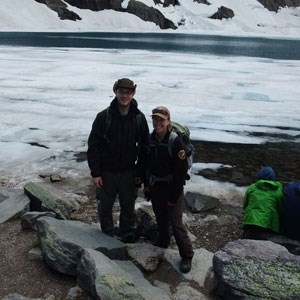 two people standing in front of icy bay