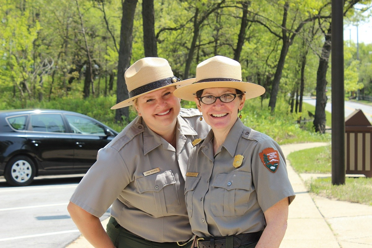 Two female park rangers smiling