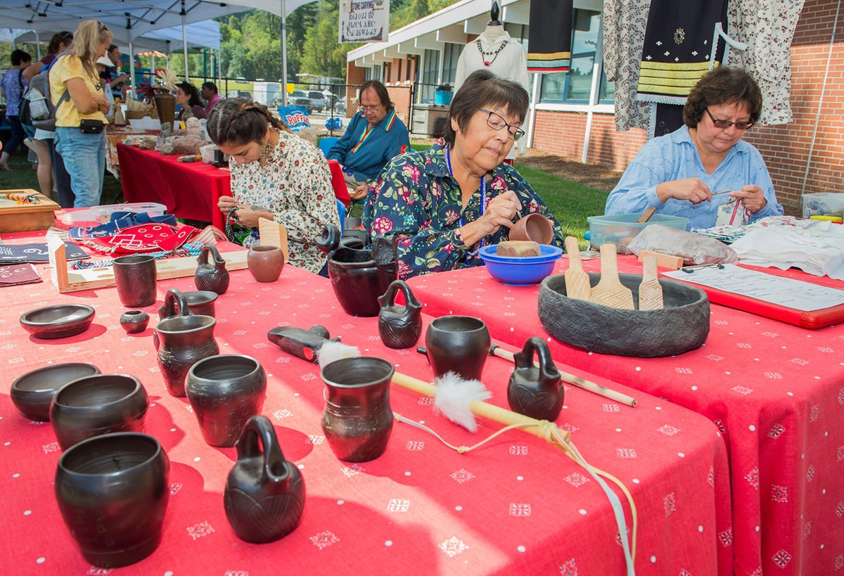 Cherokee women work on pottery and other crafts at Mountain Heritage Day in the Blue Ridge NHA