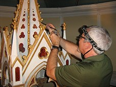 Man painting a church icon