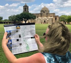 Visitor holding a park map