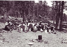 Civilian Conservation Corps (CCC) men taking a lunch break at Rocky Mountain National Park, c. 1930s. NPS Photo by George A. Grant.