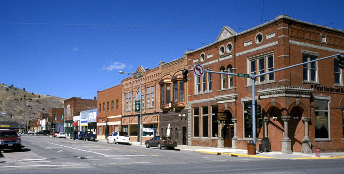 Downtown Anaconda, Montana, in 2010. Two-story red brick buildings with a bright blue sky in the background.