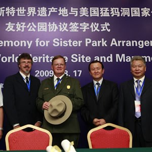 The Mammoth Cave National Park superintendent attends a formal dinner in China to sign a sister park arrangment document.