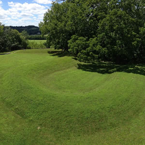 A grass covered mound within Serpent Mound State Memorial.