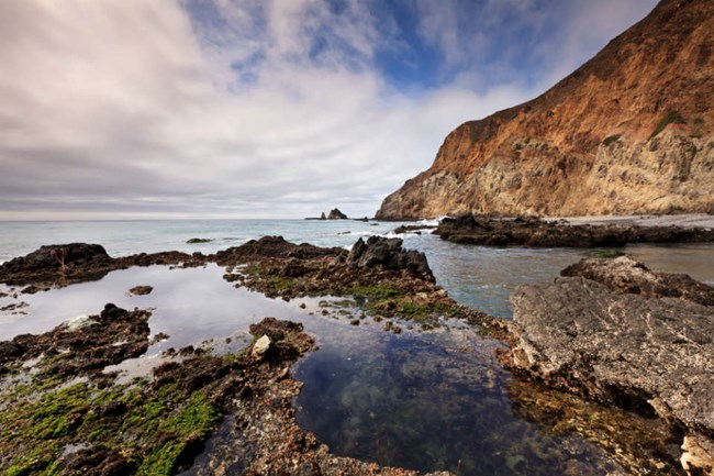 rocks emerging from intertidal zone at the edge of Anacapa Island