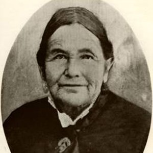 Historic photo of elderly woman in black dress.