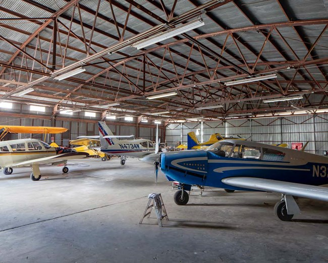 small airplanes in a hangar