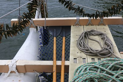 View of rope rigging, oars and the deck of a boat