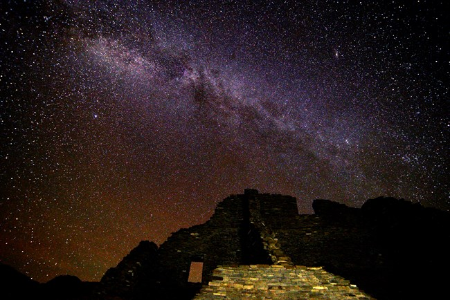 Milky Way rises about Puebloan ruins at Chaco Culture National Historical Park.