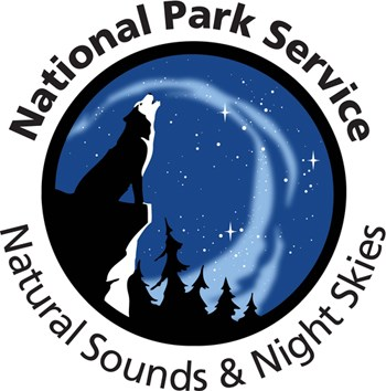 Natural Sounds and Night Skies logo features a howling wolf under a starry night sky