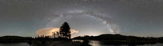 Panorama of the night sky and silhouetted horizon at Rocky Mountain National Park, Colorado.