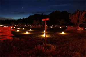A naturally dark setting enhances the impact of luminaries honoring the fallen soldiers at Shiloh National Military Park.