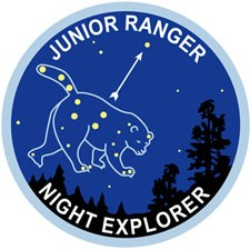 The Ursa Major constellation (the bear) is featured on this illustration of the Junior Ranger Night Explorer patch.