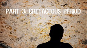 a rock wall with a silhouette of a person in front. a roaring t rex skull and the words Part 3 Cretaceous Period on it