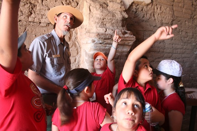 Ranger and students exploring the inside of the mission church
