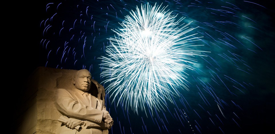 Fireworks appear over the statue of Martin Luther King Jr
