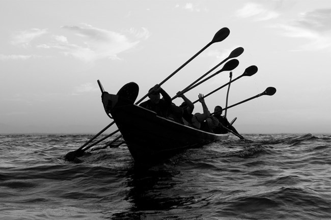 chumash paddling traditional tomol on the ocean