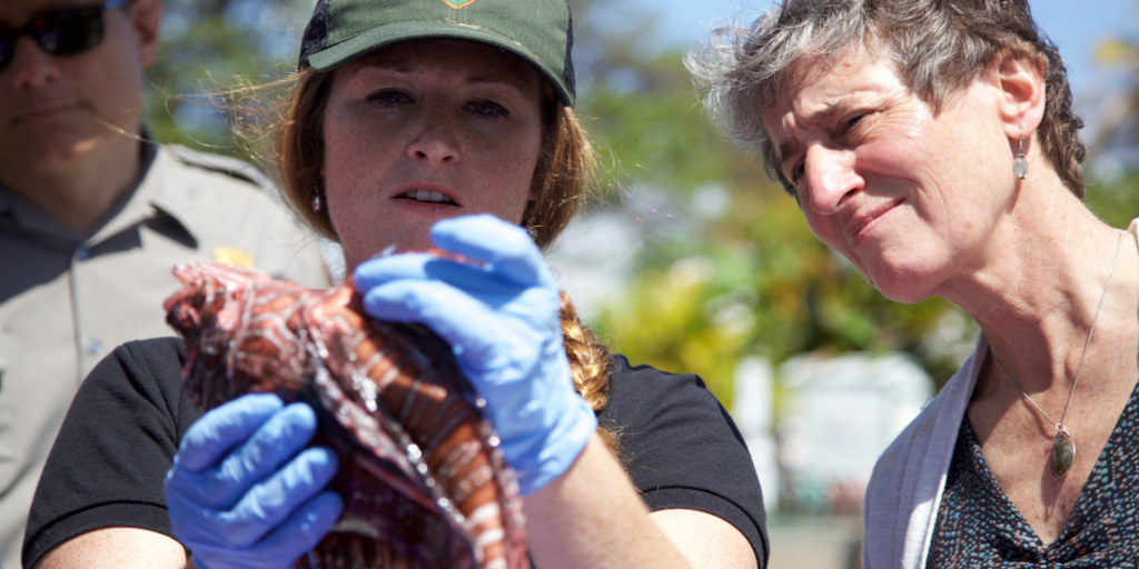 Secretary Jewell of the Department of Interior is shown a lionfish.