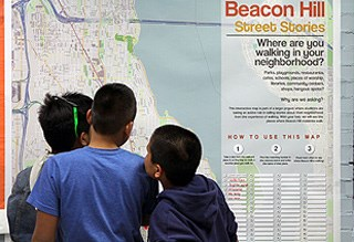 Kids view a map of Beacon Hill.