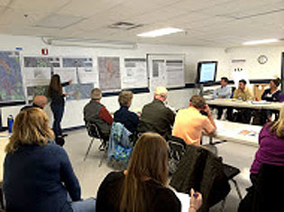 Members of several organizations attend a design workshop.