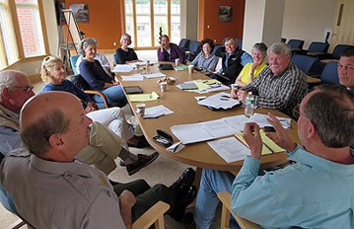 Members of the Friends of Acadia and National Park Service are gathered around a table during a meeting.