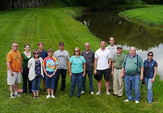 Members of a planning team pose for a group photograph in Johnson Park near the Elkhorn River.