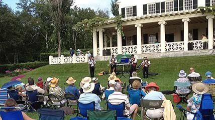 An audience enjoys a summer outdoor concert on the lawn at Saint-Gaudens National Historic Site.